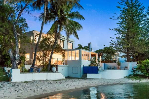 White Beach House on Rare River Position in Budds Beach